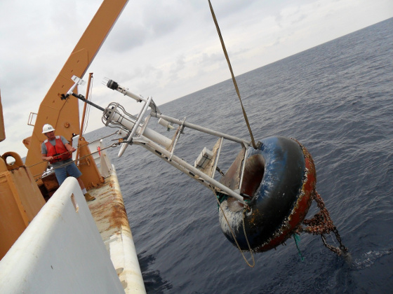Photo of TAO buoy beign retrieved to ship